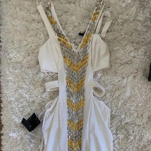 Stunning gold and white cut out dress